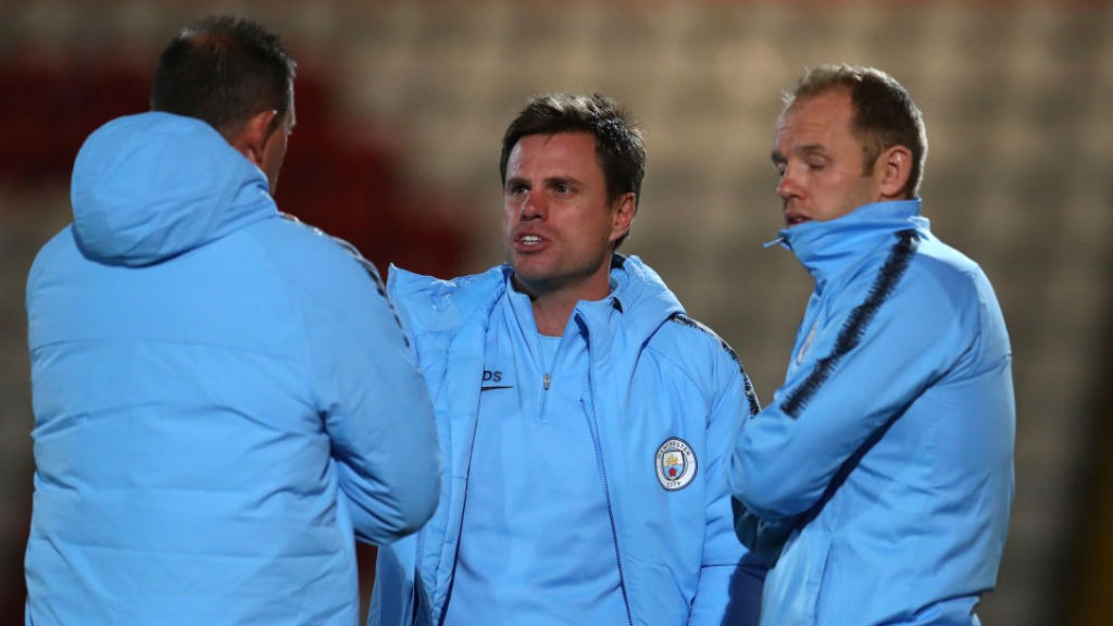 REFLECTIONS: Manchester City EDS manager Paul Harsley (centre)