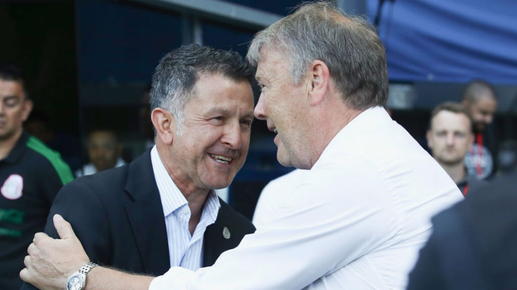 BLUE REUNION: Age Hareide greets Paraguay boss Juan Carlos Osorio, who spent five years in City's backroom staff