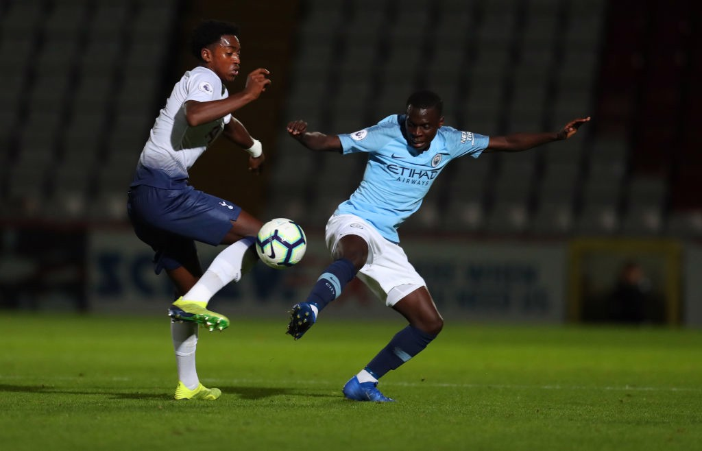 MIDDLE MARCH: Claudio Gomes challenges Tottenham's Paris Maghoma