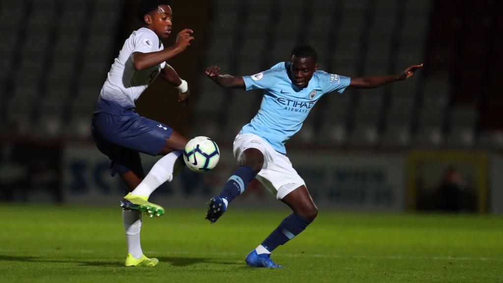 MIDDLE MARCH: Claudio Gomes challenges Tottenham's Paris Maghoma