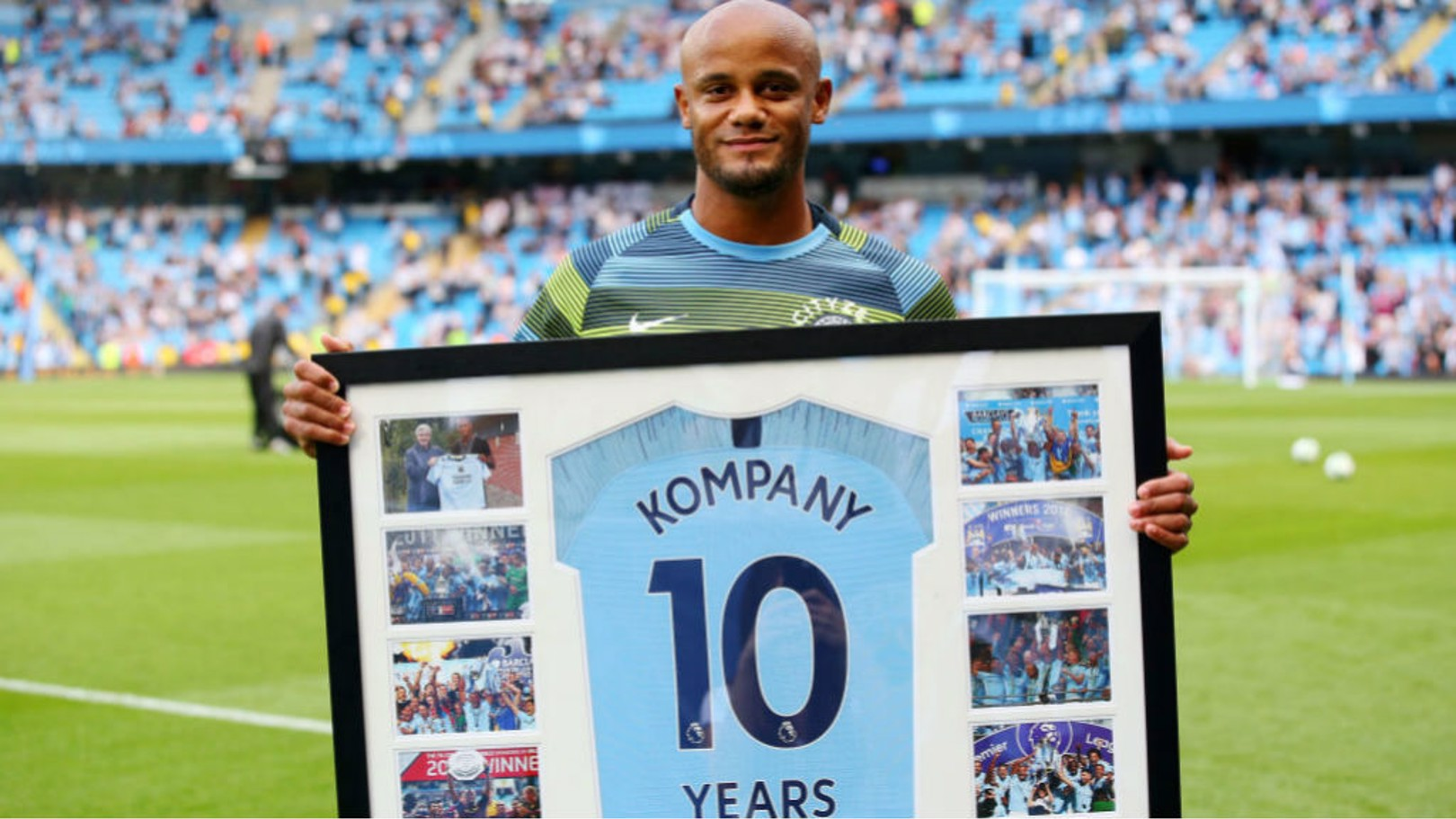 PERFECT 10: Vincent Kompany was presented with a special framed shirt to mark his decade at City prior to last Saturday's match against Newcastle
