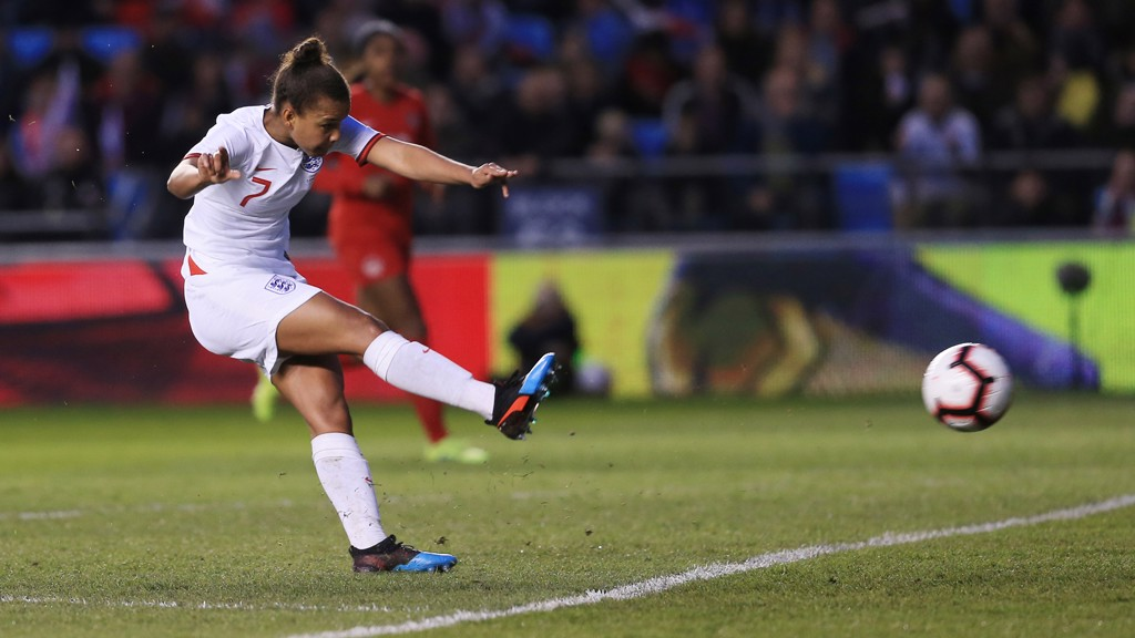 APPLYING PRESSURE: Nikita Parris angles an effort towards the Canada net