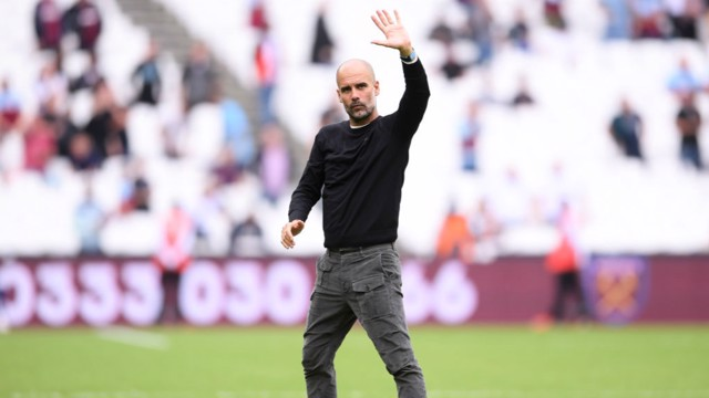JOB DONE: Pep salutes the travelling fans at the London Stadium.