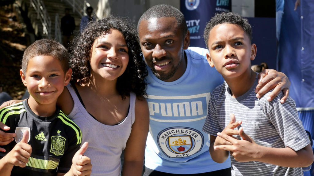 ALL SMILES: Shaun Wright-Phillips with some happy youngsters during our recent Trophy Tour to Brazil