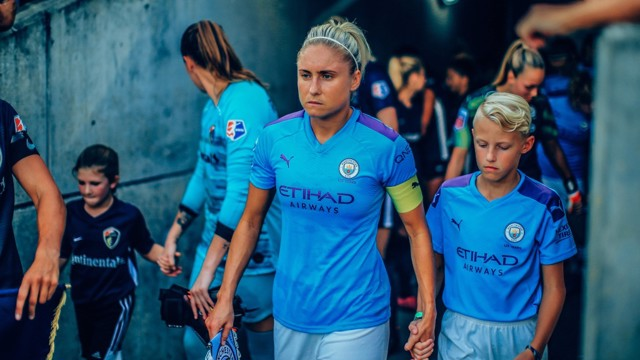 FOCUSSED: Steph Houghton leads out her side in the US.