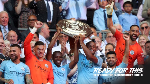 SILVERWARE: Vincent Kompany lifts the Community Shield aloft.