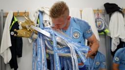OURS: Oleks Zinchenko plants a kiss on the Premier League trophy.
