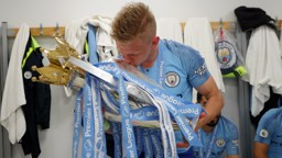 OURS: Oleks Zinchenko plants a kiss on the Premier League trophy.