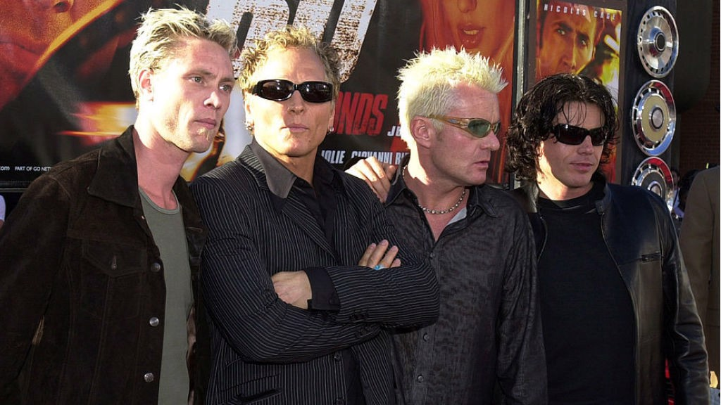 HOLLYWOOD LIFE: Billy (second right) with fellow members of the Cult at an LA film premiere back in 2000