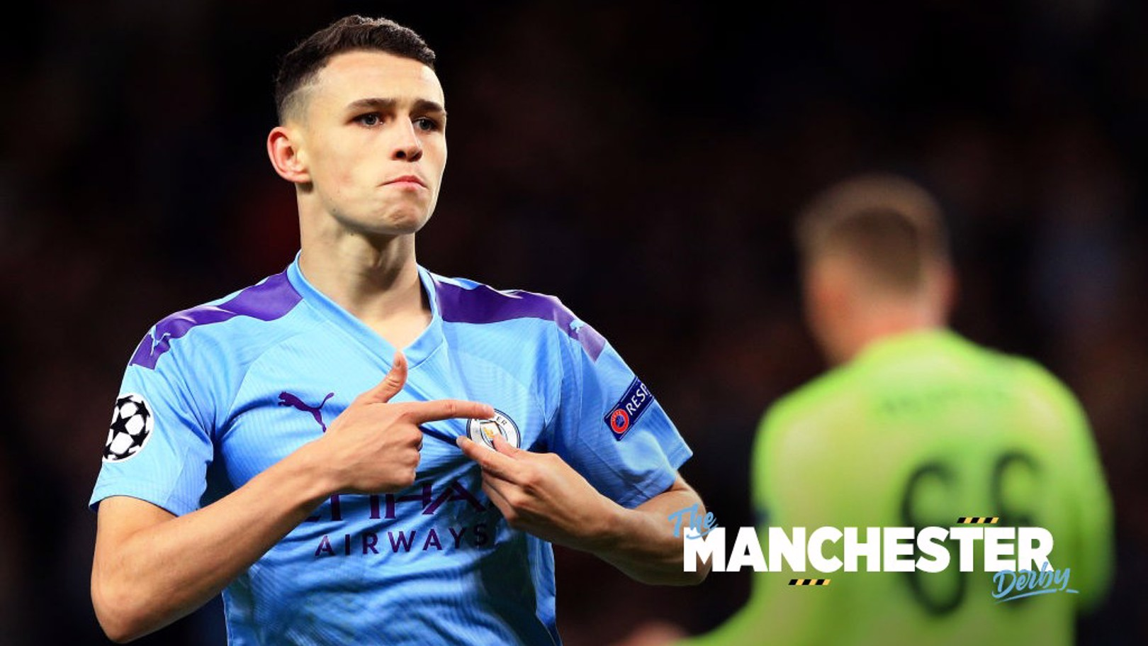 FAN: Phil Foden points to the badge of the Club he loves.