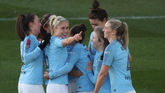 ALL TOGETHER NOW: The Blues celebrate City's third goal of the day