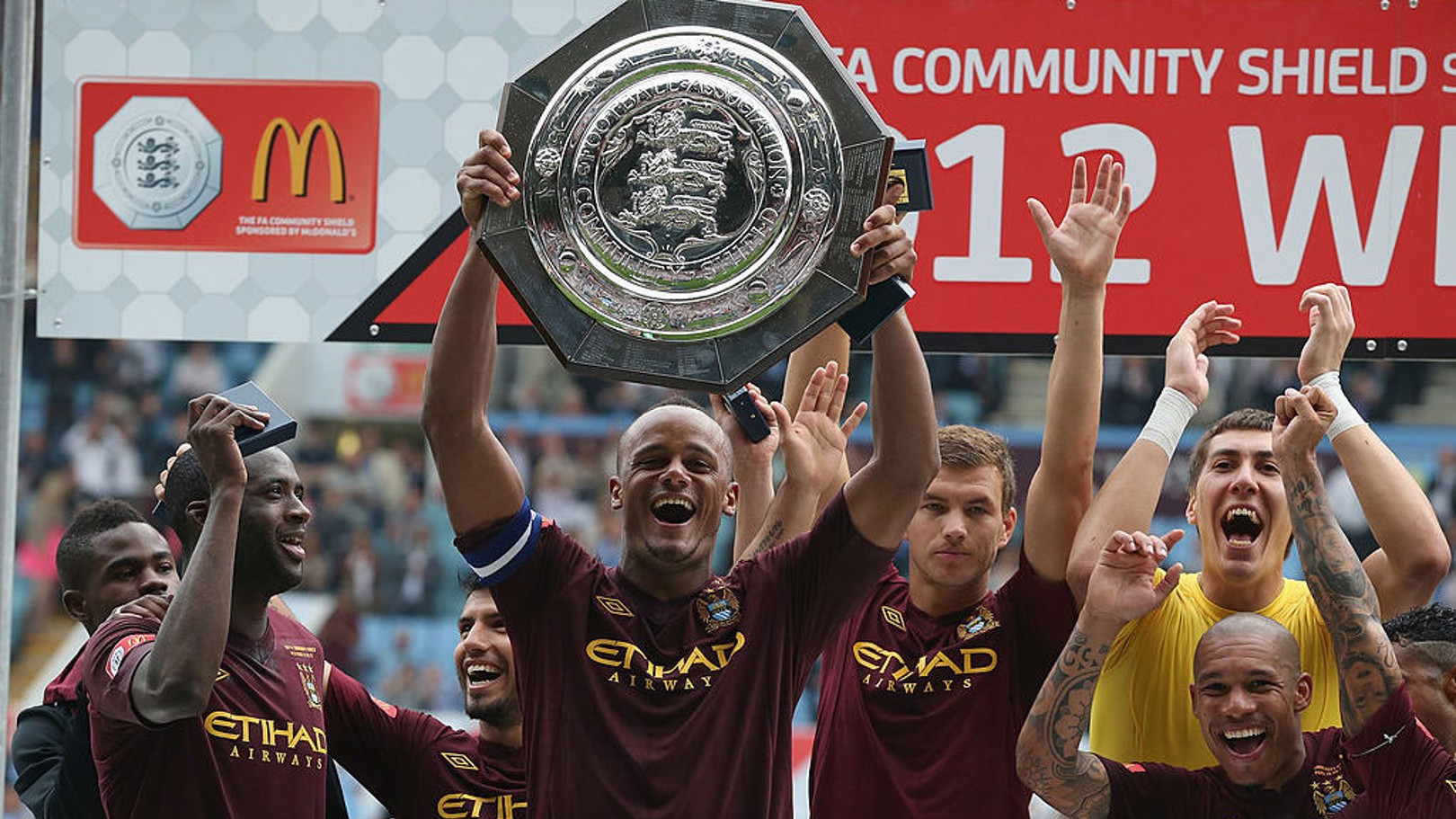 ALL SMILES: Vincent Kompany lifts the Community Shield as City celebrate after our 3-2 victory over Chelsea in 2012