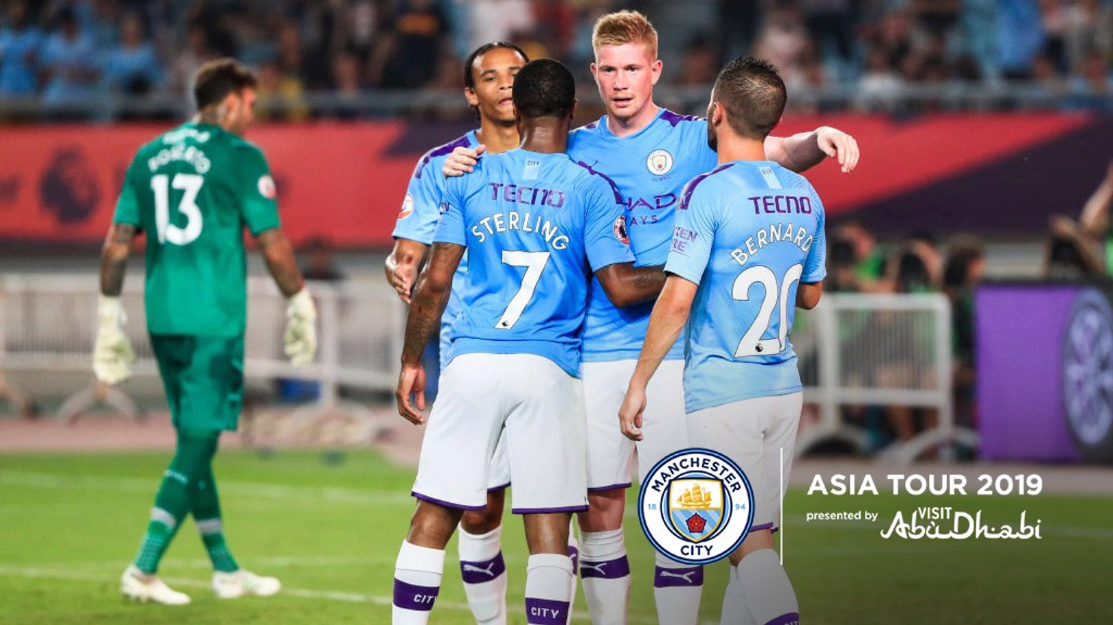 CELEBRATION: Kevin De Bruyne congratulates Raheem Sterling in Nanjing.