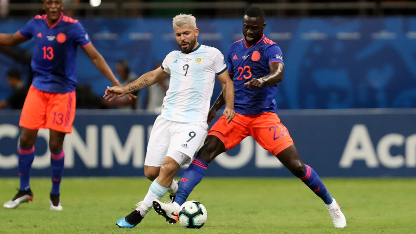 ACTION MAN: Sergio Aguero looks to gain possession from Colombia's Davinson Sanchez