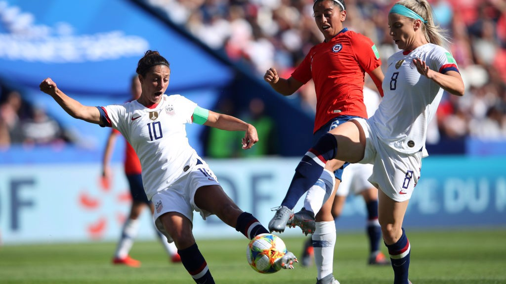 ACE: Carli Lloyd catches the ball sweetly for her opening goal against Chile.