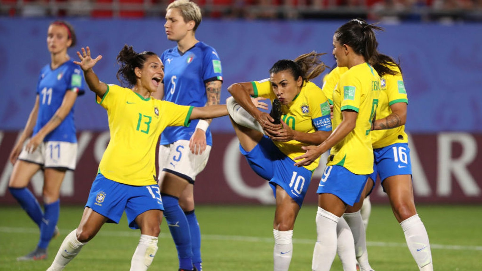 FILL YOUR BOOTS! Marta of Brazil celebrates with teammates after making World Cup history against Italy