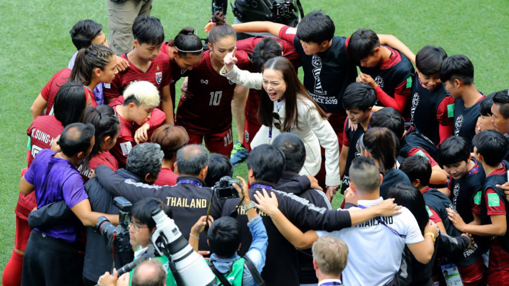 LAYING DOWN THE LORE: Manager Nualphan Lamsam gives instructions to the Thailand players in a team huddle prior to the 2019 Women's World Cup  group F match with Sweden