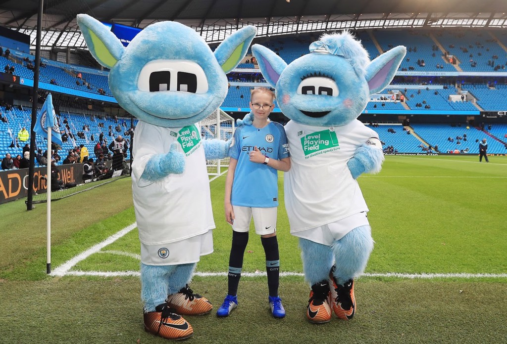 Ryan with club mascots Moonbeam and Moonchester