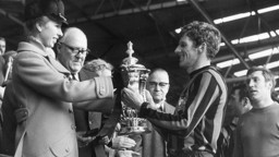 UNFORGETTABLE:  A proud Manchester City skipper Tony Book receives the FA Cup from Princess Anne at Wembley after our 1969 final triumph over Leicester City