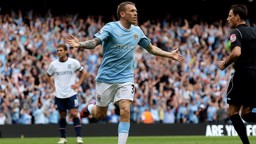 JOY: Craig Bellamy wheels away after scoring for City against Aston Villa.