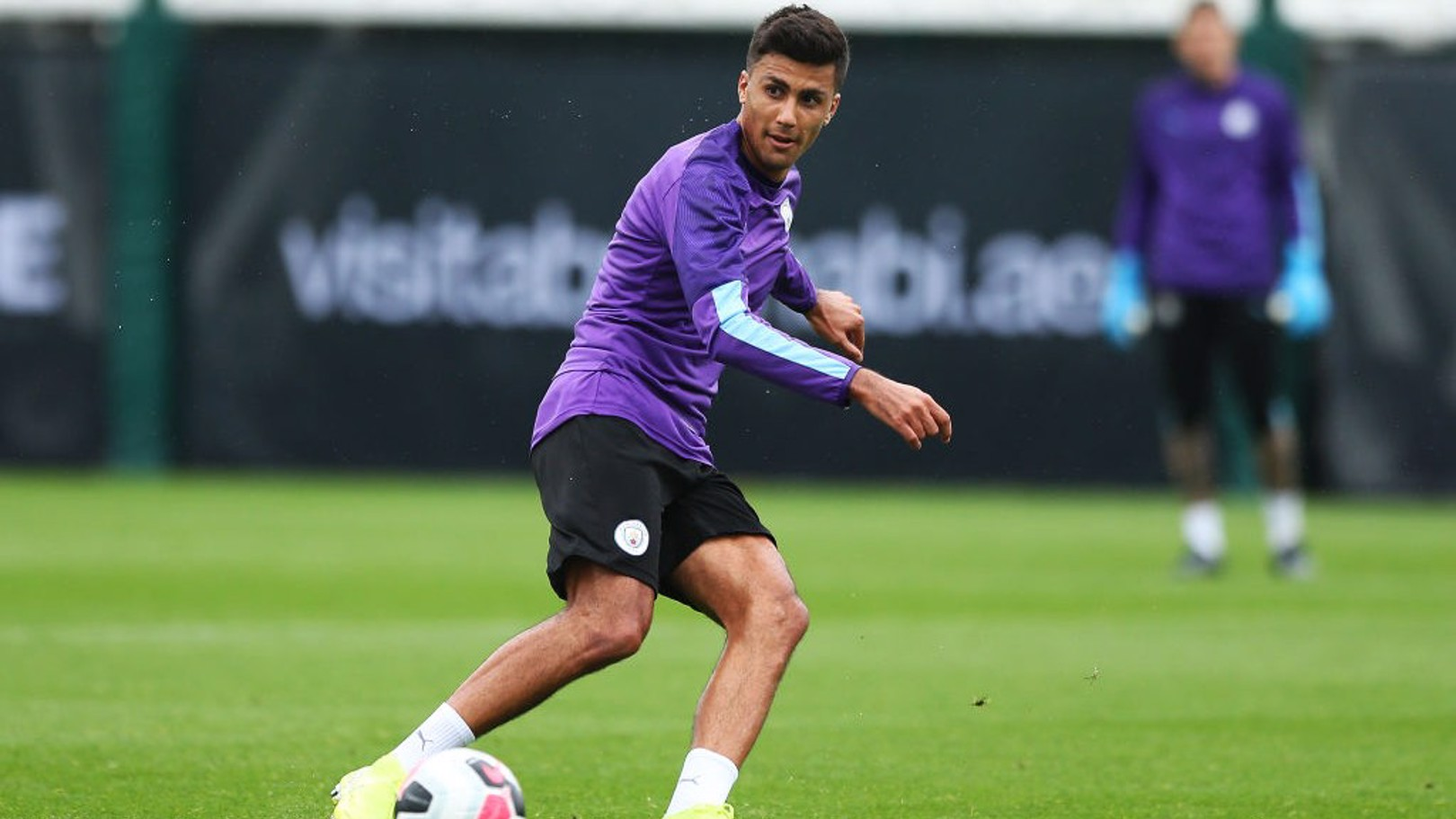 ON THE MOVE: Rodri takes the ball in training.