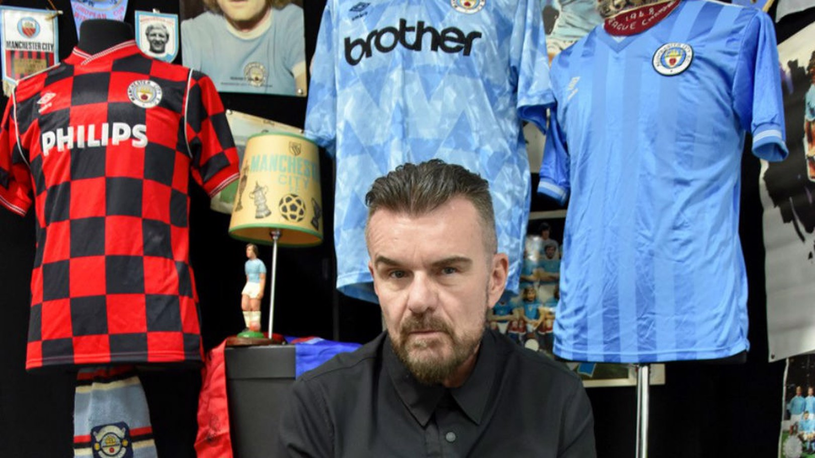 TRUE BLUE: Billy Duffy with just some of his collection of City memorabilia which is up for auction later this month