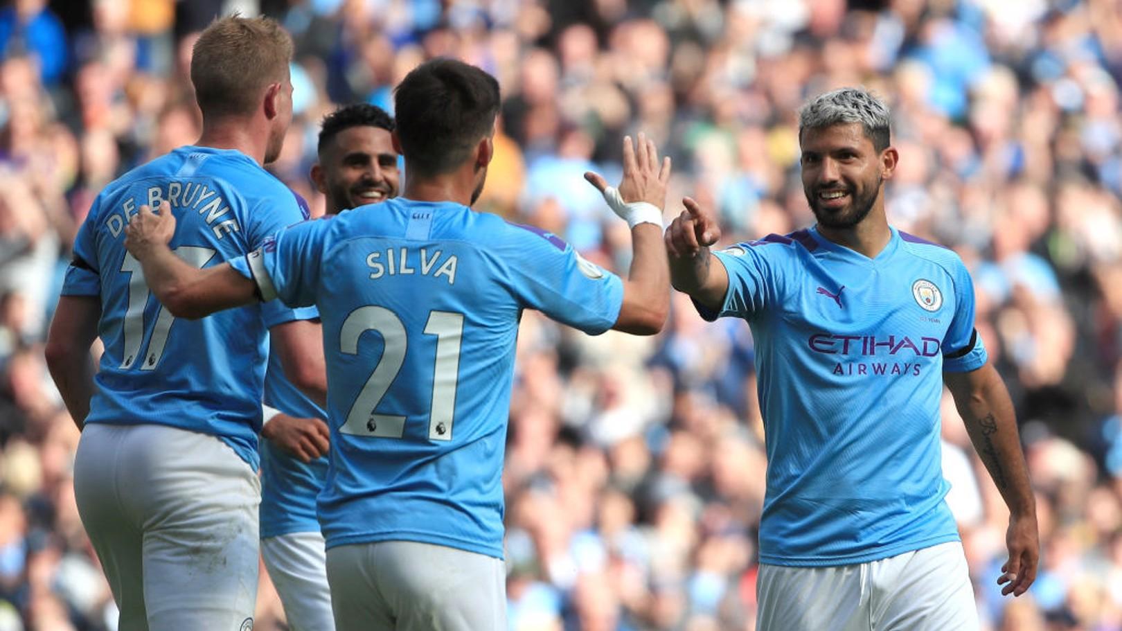 GET IN: Sergio Aguero celebrates against Brighton.