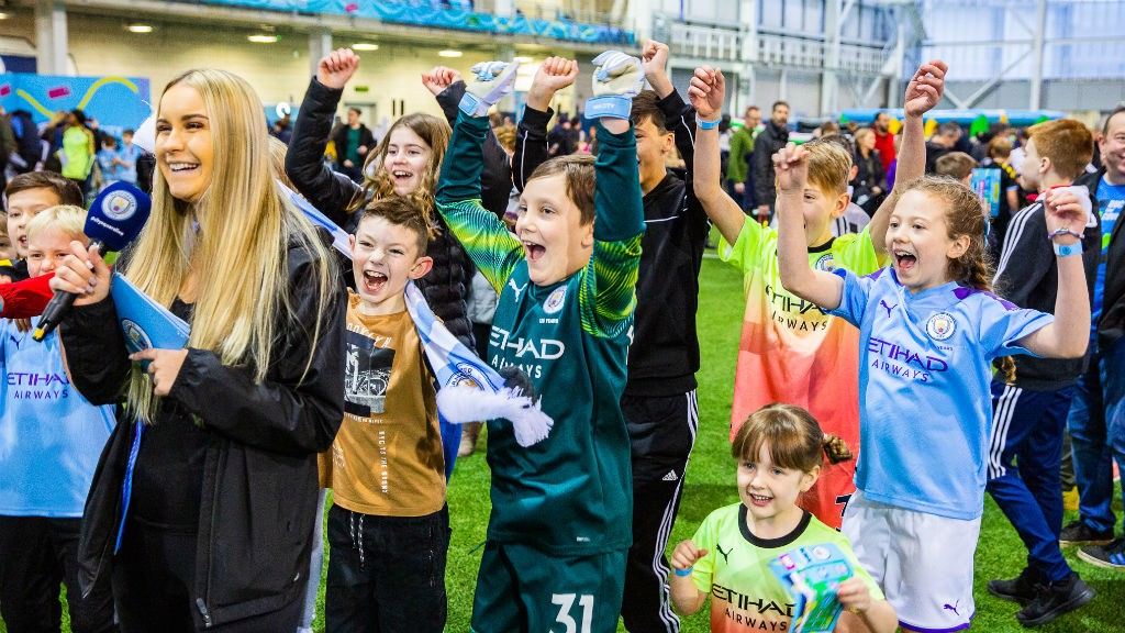 ALL SMILES: Just some of the happy youngsters at today's City Fanzone event