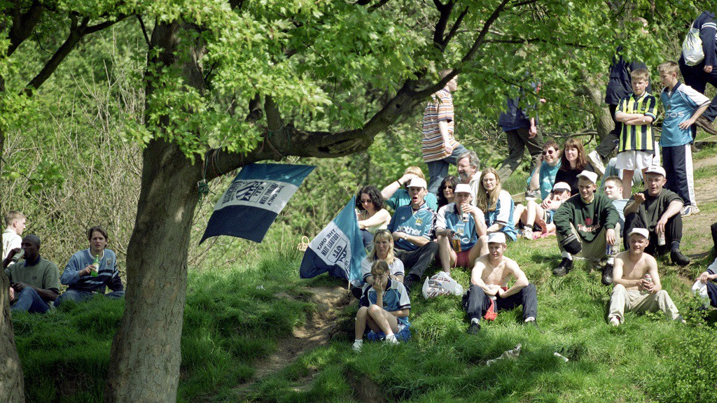 HILL VIEW: City fans gather to see the action