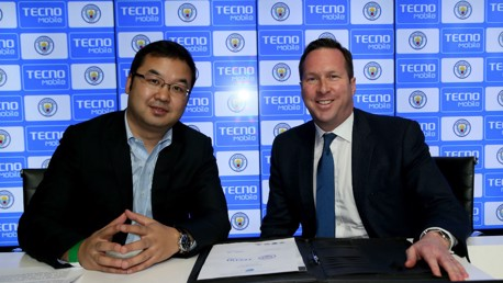 SIGNED: Stephen Ha, TECNO Mobile's Managing Director, and Tom Glick, Chief Commercial Officer for City Football Group, moments after signing the partnership agreement between TECNO Mobile and Manchester City.