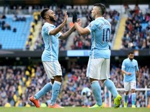 PARTNERSHIP: Raheem Sterling and Sergio Aguero celebrate a goal against Aston Villa.