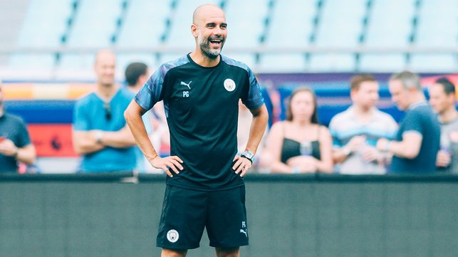 BOSSING IT : Pep watches on...