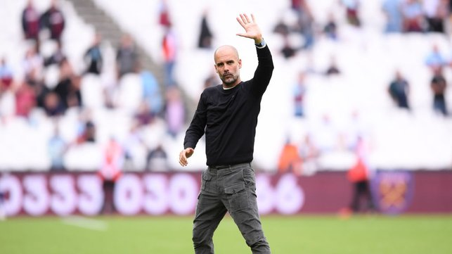 JOB DONE : Pep Guardiola acknowledges City's support after a fine afternoon's work in the capital.