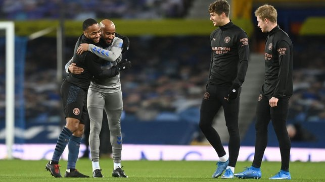 OLD FRIENDS : Raheem Sterling embraces with former City man, Fabian Delph ahead of kick-off.