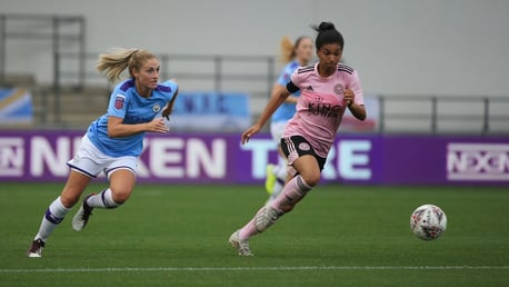 ON THE RUN: Laura Coombs gives chase against Leicester City.