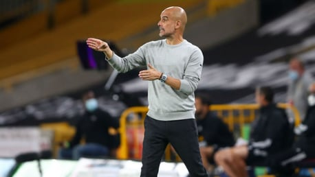 THE BOSS: Pep Guardiola gets his point across to the City players