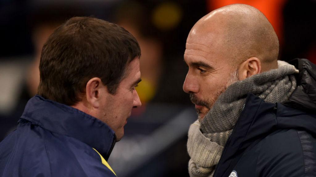MUTUAL RESPECT : Pep Guardiola greets Burton counterpart Nigel Clough