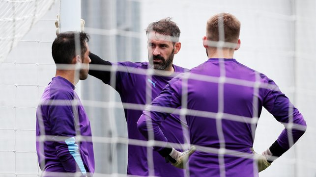 NEW BOY : Scott Carson chats with his new teammates.
