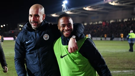 SMILES ALL ROUND: Pep and Raheem celebrate as the final whistle is blown.