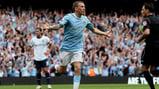 JOY: Craig Bellamy wheels away after scoring for City against Aston Villa.