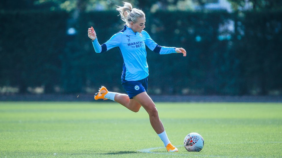 BY THE LEFT: Alex Greenwood whips in a cross