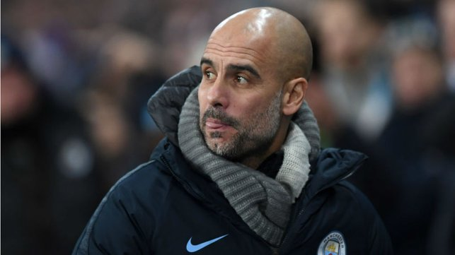 EYES FRONT : Pep Guardiola watches over proceedings