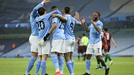 SQUAD GOALS: The lads celebrate the breakthrough