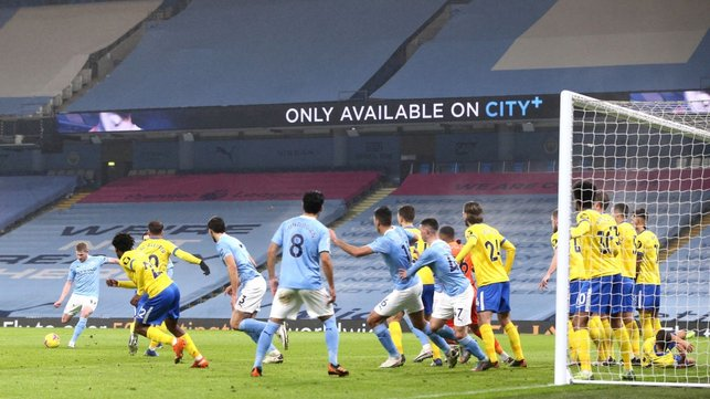FULL HOUSE :  The players crowd the six yard box as De Bruyne's indirect free-kick is blocked.