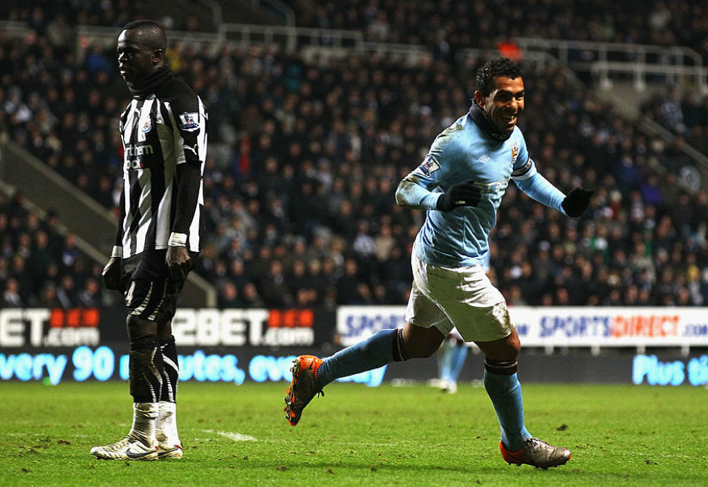 THREE CHEERS: Carlos Tevez starts the celebrations after sealing victory
