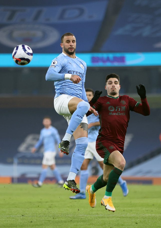 WALKER IN THE AIR: Kyle Walker brings the ball down under pressure from Pedro Neto