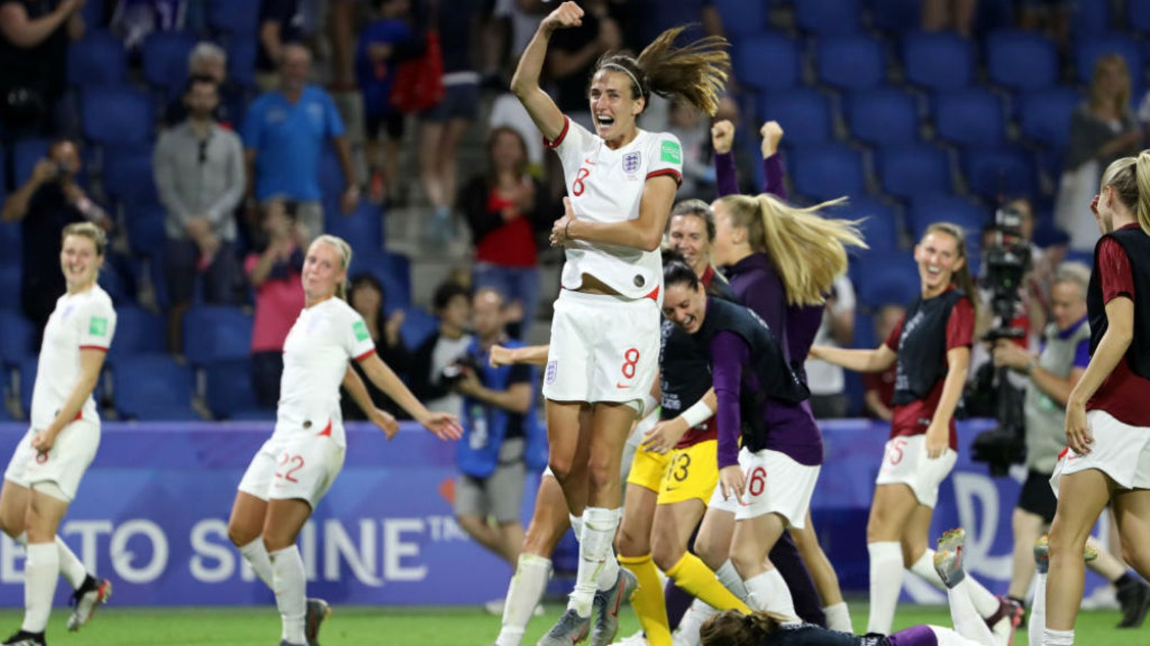 JUMPING FOR JOY: Jill Scott can't contains her delight as England celebrate after their 3-0 World Cup quarter-final win over Norway