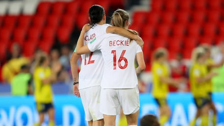 SISTERS IN ARMS: Christine Sinclair comsoles Janine Beckie