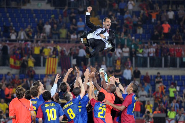 TREBLE WINNERS : In his first season Guardiola guides Barcelona to the treble, becoming the first team to do so in Spanish football history