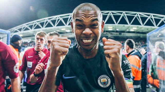 THAT WINNING FEELING : Fernandinho can't contain his joy after our hard-fought win away at Huddersfield in 2017